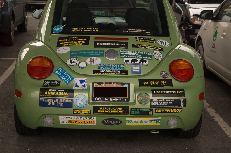 A car covered in harry potter bumper stickers